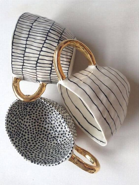 handmade ceramic mugs by suzanne sullivan black and white patterns with gold handles
